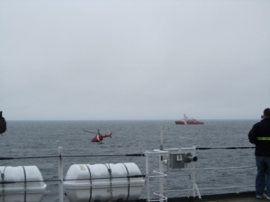 Here's a look at the helicopter approaching the helo pad aft on Healy and flying back to the Louis.