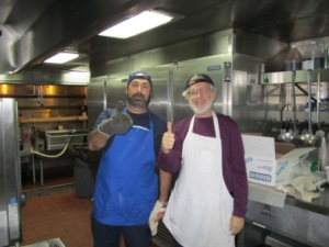"""Captain Michel Bourdeau and Jerry manned the pizza ovens with great style and flair, earning the self-proclaimed designation """"SPT"""" or Ship's Pizza Technicians."""