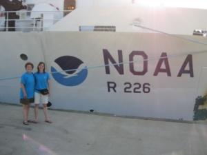 Nicolle von der Heyde and Melinda Storey standing in front of the docked Pisces