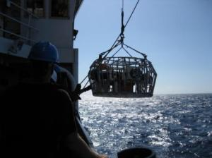 """Camera Array being """"dropped"""" into the ocean by a crane"""