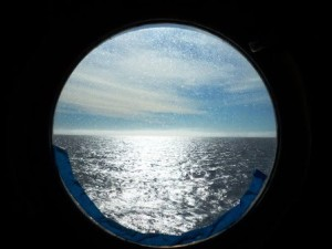 Sun on Water Through Porthole