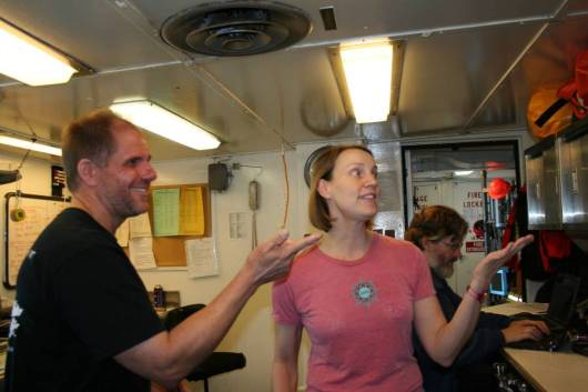Steve De Blois, NOAA Research Fishery Biologist, shares acoustic datawith Julia Clemons, NOAA Oceanographer, aboard the Miller Freeman.