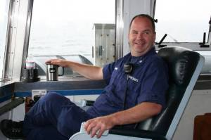 Commander Mike Hopkins overlooks the North Pacific Ocean just off the Oregon Coast from the bridge. His job is to make sure everything aboard the Miller Freeman is running smoothly.