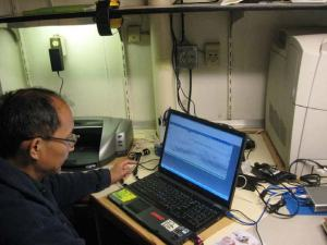 Here is Dr. Chu using a sonar readout to determine where the hake are located.