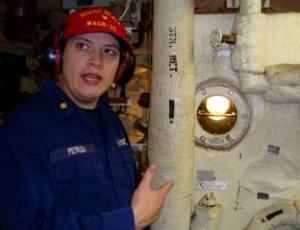 Lieutenant Commander Doug Petrusa wearing protective headset