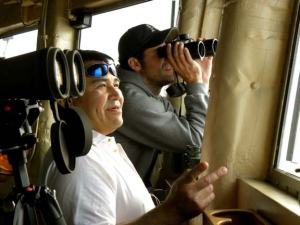 George Neakok (left) and Justin Pudenz watch for marine mammals from the bridge of the Healy.