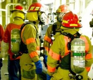 The crew is suiting up for a Friday drill. Each member of the crew is trained to do many different jobs in case of an emergency.
