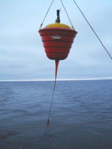 A Seasonal Ice buoy with a thermistor chain is deployed from the Healy. This buoy starts in open water and later may