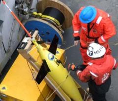 CDR Bill Sommer, AG1 Richard Lehmkuhl, and MST3 Marshal Chaidez deploy a Seaglider from the Healy in the Chukchi Sea. Data from the Seaglider will improve the performance, and aid in the evaluation, of the effectiveness of the ocean models in the Arctic. Photo courtesy of PA3 Patrick Kelley, USCG.