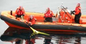 Coast Guard and Navy personnel work together to retrieve the Seaglider on September 13.