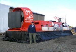 Dr. Hall standing by the hovercraft before it is inflated
