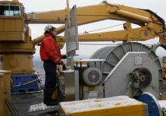 MST3 Marshal Chaidez operates the winch during a dredging operation.