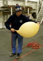 Mrs. Hedge fills the weather balloon