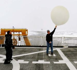 AG1 Lemkuhl shows Mrs. Hedge how to launch a weather balloon.