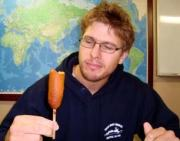 Yoann, a student from France, enjoys his first corndog