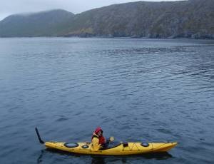 Paddling my kayak in the ocean through Northwest Harbor in the Shumagin Islands