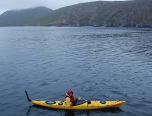 Paddling my kayak in the ocean through Northwest Harbor in the Shumagin Islands