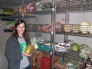 Here I am examining the ship's food stores.  This is the fresh fruit and vegetable section of the cooler, but there are many other sections as well.