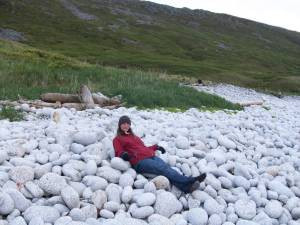 "TAS Joivell relaxes on Little Koniuji Island at about 11:00pm.  As you can see, it is still daylight out.  I called this area ""Dinosaur Egg Beach"" because of the shapes, textures, and colors of the rocks."