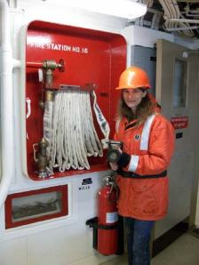 Practicing the proper technique with a fire hose.  These hose stations are located in a variety of spaces all around the ship.