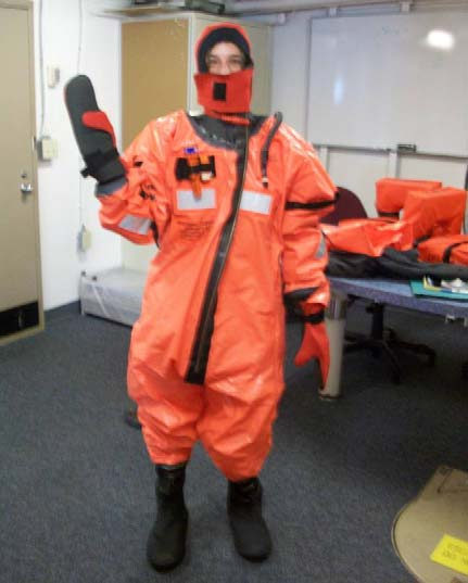 Here I am in my emergency suit.  This suit can protect you even in the coldest waters.  Along with life preservers, hats, and coats, suits must be brought to life raft musters during abandon ship drills.