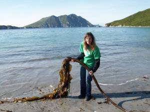 TAS Joivell displays some of the kelp found on the beach at Big Koniuji Island.  The tube like part is full of air and the leaves feel like plastic.