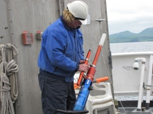 Chief Boatswain Jimmy Kruger demonstrates how to use a line-throwing device, the PLT.