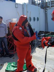 Here I am practicing donning my emergency immersion suit.