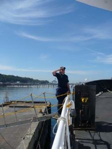 Ensign Heather Moe coming aboard the Miller Freeman in Port Angeles, Washington