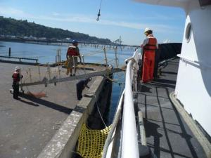Deck crew preparing to load gang plank Tuesday afternoon, 3:30 pm