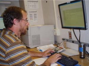 Geoff Cook entering data from his dive onto a central database in the dry lab.