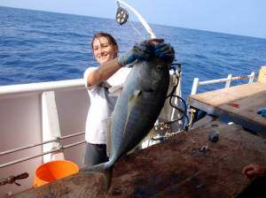 Here is a picture of me holding up the Butaguchi I caught. If you look in the background you can see the hydraulic bottom fishing rig that was used to catch the fish.