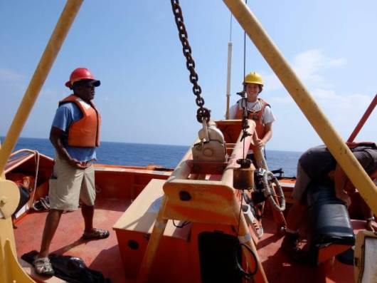 Here is a picture of me in the safety boat, about to be lowered down so that we can deliver fresh fish to the near by NOAA vessel.