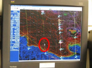 This is the screen I use to get info about our ship's location.  The little white speck inside the red oval is our ship.