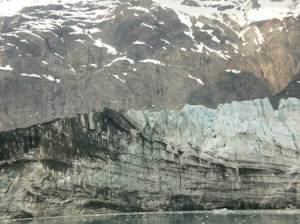 Black debris covers part of the glacier