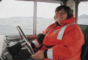 Here I am driving the launch.  It is essential to hold a steady course while collecting data for the surveys and tests.
