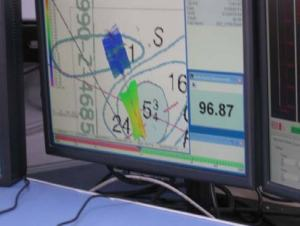 "The chart of the area is ""painted"" with color depicting the depth of the area based upon the return form the sonar.  The goal is to ""paint"" your assigned area.  The numbers in the lower right of the screen indicate the depth in meters."