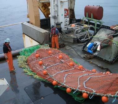 The deck crew works a full net aboard NOAA Ship OSCAR DYSON.