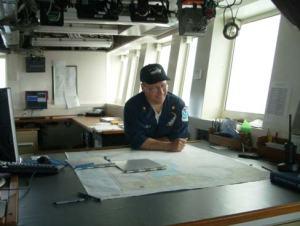 NOAA's Lieutenant Commander D. ZezulaReading the chart of the North Bering Sea
