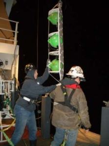Adrienne and Travis test the empty peacameras   pods for pressure down to 80 meters