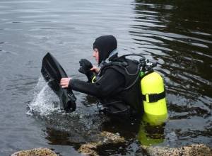 NOAA divers retrieve a submerged tidal gauge