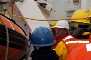 The Chief Boatswain going over emergency procedures for getting the emergency boat deployed.