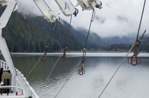 Davits ready to welcome the launches back to the ship.