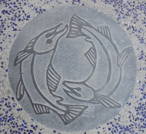 Humpback salmon emblazoned into the sidewalk
