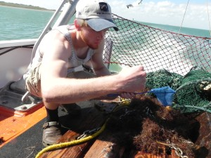 Student sorting through the otter trawl on the Katy