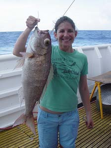 Meaghan Darcy with a 70.2cm opakapaka (Pristopimoides filamentosus).
