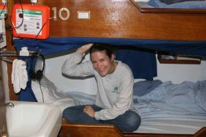 Tara Fogleman, a NOAA Teacher-at-Sea participant, hangs out in her bottom bunk aboard the JOHN N. COBB.