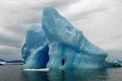 Chief Scientist Dave Withrow poses on an iceberg near the LeConte Glacier.