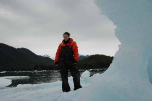 Tara Fogleman, a NOAA Teacher at Sea participant, poses on an iceberg in southeastern Alaska.