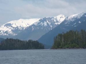 Snowcapped mountains surround the inside passage south of Juneau, AK